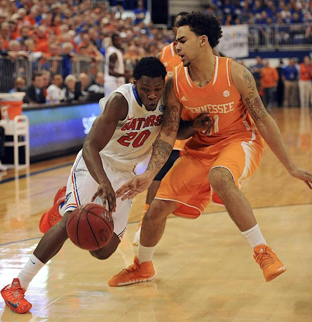 Florida guard Michael Frazier II (20) drives for the basket as Tennessee guard Quinton Chievous (31) defends during the second half of an NCAA college basketball game Saturday, Jan. 25, 2014 in Gainesville, Fla. (AP Photo/Phil Sandlin)
