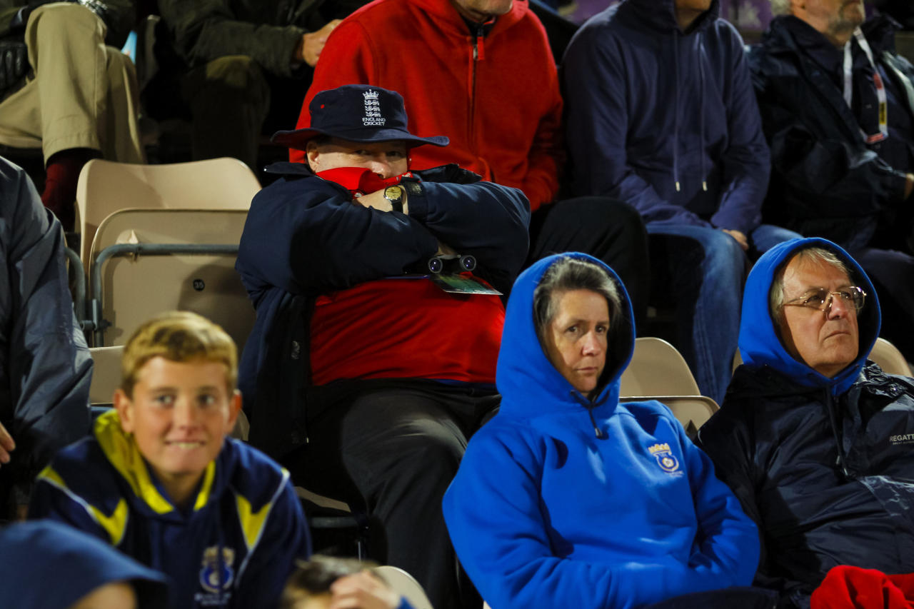 Cricket fans huddle under coats and blankets while watching the Fifth One Day International in chilly conditions at the Ageas Bowl, Southampton.