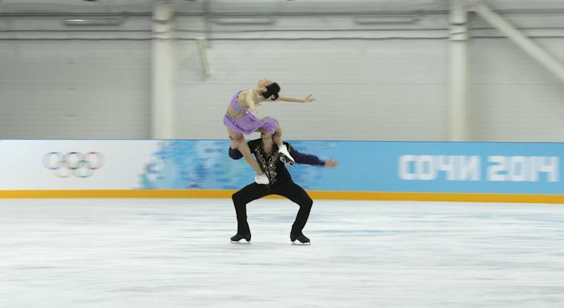 Meryl Davis and Charlie White of the United States skate at the figure skating practice rink ahead of the 2014 Winter Olympics, Wednesday, Feb. 5, 2014, in Sochi, Russia. (AP Photo/Ivan Sekretarev)