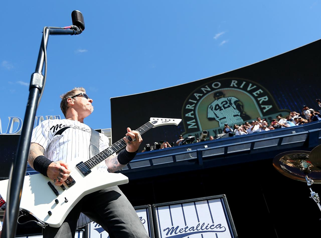 NEW YORK, NY - SEPTEMBER 22: James Hetfield of Metallica performs Enter Sandman to honor pitcher Mariano Rivera #42 of the New York Yankees during the Mariano Rivera Day pregame ceremony during interleague against the San Francisco Giants play on September 22, 2013 at Yankee Stadium in the Bronx borough of New York City. (Photo by Elsa/Getty Images)