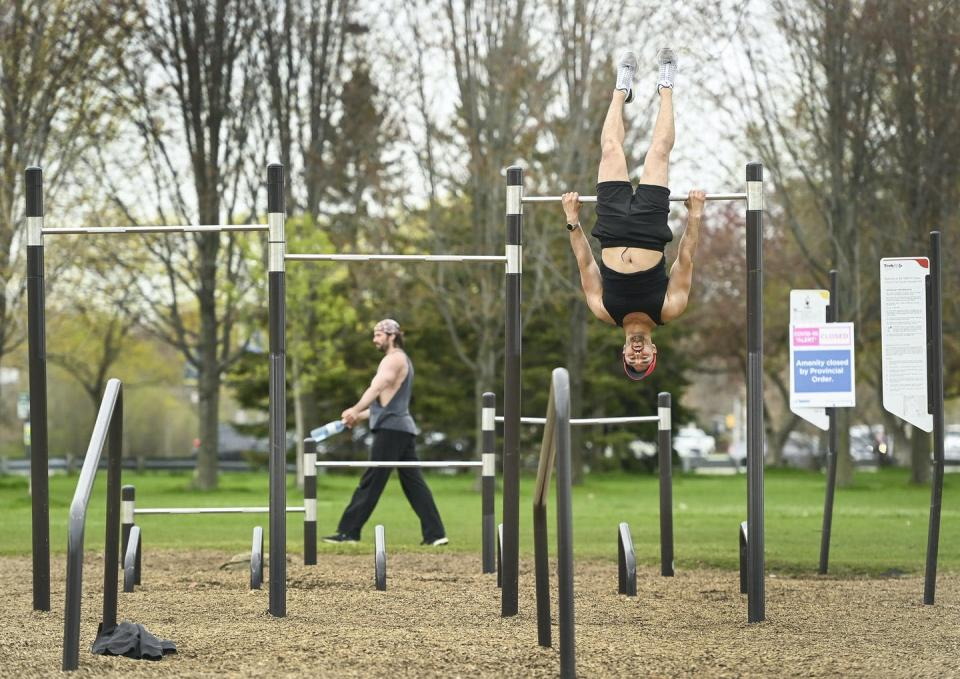 People work out at an outdoor gym located along Lake Ontario during COVID-19 in Toronto.