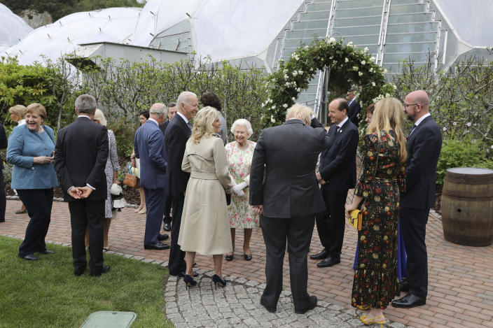 Britain's Queen Elizabeth II speaks to US President Joe Biden and his wife Jill Biden during a reception with the G7 leaders at the Eden Project in Cornwall, England, Friday June 11, 2021, during the G7 summit. (Jack Hill/Pool via AP)