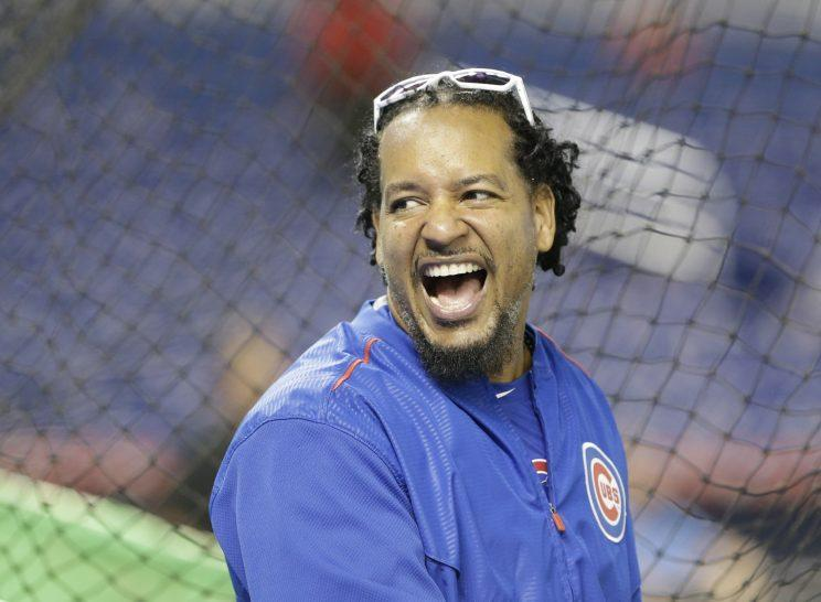 Chicago Cubs hitting consultant Manny Ramirez laughs as he watches practice before a baseball game between the Miami Marlins and the Chicago Cubs, Monday, June 1, 2015, in Miami. (AP Photo/Wilfredo Lee)