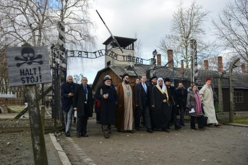 Muslim World League head Mohammad bin Abdulkarim Al-Issa and American Jewish Committee leader David Harris among those at the infamous gates of the former Nazi German death camp Auschwitz