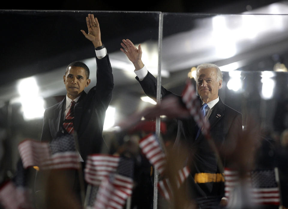 President-elect Barack Obama, left, and Vice president-elect Joe Biden wave to the crowd at their election night party at Grant Park in Chicago, Tuesday night, Nov. 4, 2008. (AP Photo/David Guttenfelder)
