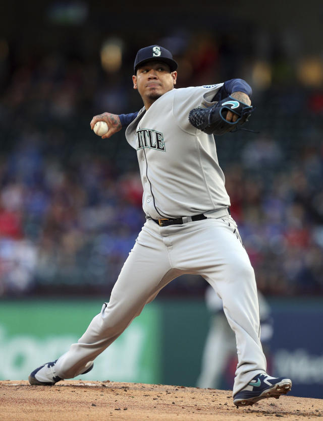 Seattle Mariners starting pitcher Felix Hernandez pitches against the Texas Rangers during the first inning of a baseball game Friday, April 20, 2018, in Arlington, Texas. (AP Photo/Richard W. Rodriguez)