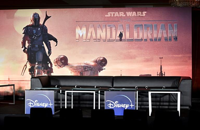 "Excited fans stayed up until the small hours to be among the first to watch ""The Mandalorian,"" a new live-action Star Wars television series which is among a handful of Disney+ exclusives available at launch"