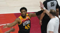 Utah Jazz guard Donovan Mitchell (45) receives high-fives as he heads to the bench during the second half of Game 5 of the team's NBA basketball first-round playoff series against the Memphis Grizzlies on Wednesday, June 2, 2021, in Salt Lake City. (AP Photo/Rick Bowmer)