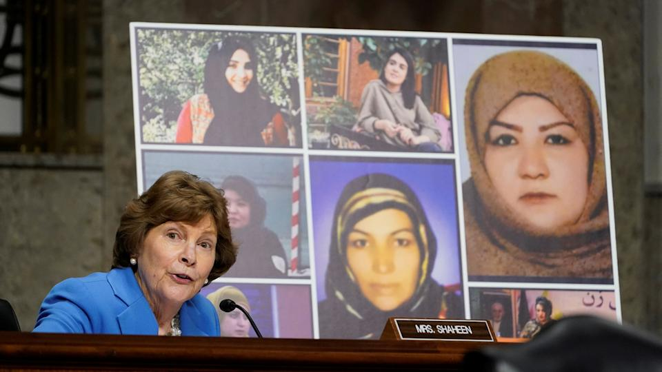 U.S. Senator Jeanne Shaheen (D-NH), talks about women in Afghanistan, including the seven pictured women who were killed in Afghanistan, as she questions Zalmay Khalilzad, special envoy for Afghanistan Reconciliation, during a Senate Foreign Relations Committee hearing on Capitol Hill in Washington, U.S., April 27, 2021. (Susan Walsh/Pool via Reuters)