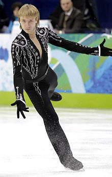 Russia's Evgeni Plushenko is in first place after Tuesday's short program