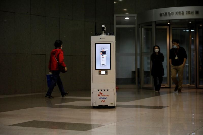 A self-driving robot travels during its demonstration at the headquarters of SK Telecom in Seoul