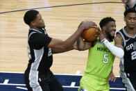 Minnesota Timberwolves' Malik Beasley (5) hangs onto the ball as San Antonio Spurs' Rudy Gay, left, tries to wrest it away in the second half of an NBA basketball game Saturday, Jan. 9, 2021, in Minneapolis. (AP Photo/Jim Mone)