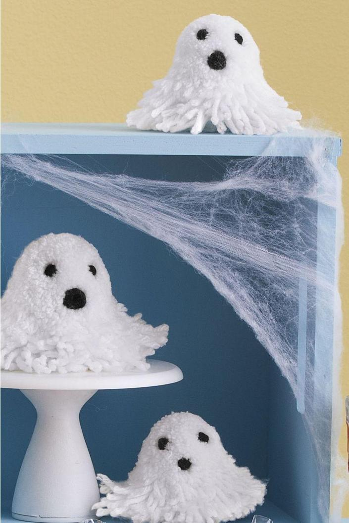 """<p>To make these cute plush ghosts, use a pom-pom maker to form a big white ball. Then, shape the ball into a ghost by trimming one side into a round head and leaving the other side long and loose. To complete, glue on small black pom-poms for the eyes and mouth.</p><p><a class=""""link rapid-noclick-resp"""" href=""""https://www.amazon.com/TOODOO-Pom-pom-Different-Knitting-Scissors/dp/B078RJTZ2B?tag=syn-yahoo-20&ascsubtag=%5Bartid%7C10070.g.2488%5Bsrc%7Cyahoo-us"""" rel=""""nofollow noopener"""" target=""""_blank"""" data-ylk=""""slk:SHOP POM-POM MAKER"""">SHOP POM-POM MAKER</a></p>"""