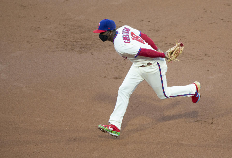 Philadelphia Phillies shortstop Didi Gregorius (18) chases a base hit by the Toronto Blue Jays' Teoscar Hernandez during the first inning of a baseball game, Saturday, Sept. 19, 2020, in Philadelphia. (AP Photo/Laurence Kesterson)