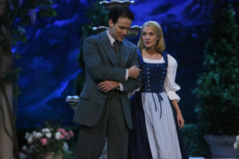 """This photo provided by NBC shows Stephen Moyer, left, as Captain Von Trapp and Carrie Underwood as Maria, in """"The Sound of Music Live!"""" airing Thursday, December 5, 2013, on NBC (8-11 p.m. ET). (AP Photo/NBC, Will Hart)"""