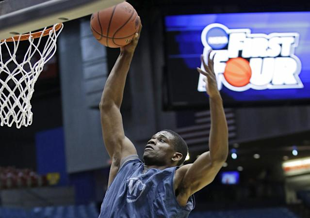 Mount St. Mary's forward Sam Prescott goes up to dunk during practice for an NCAA college basketball tournament game, Monday, March 17, 2014, in Dayton, Ohio. Albany plays Mount St. Mary's on Tuesday in a first round game. (AP Photo/Al Behrman)