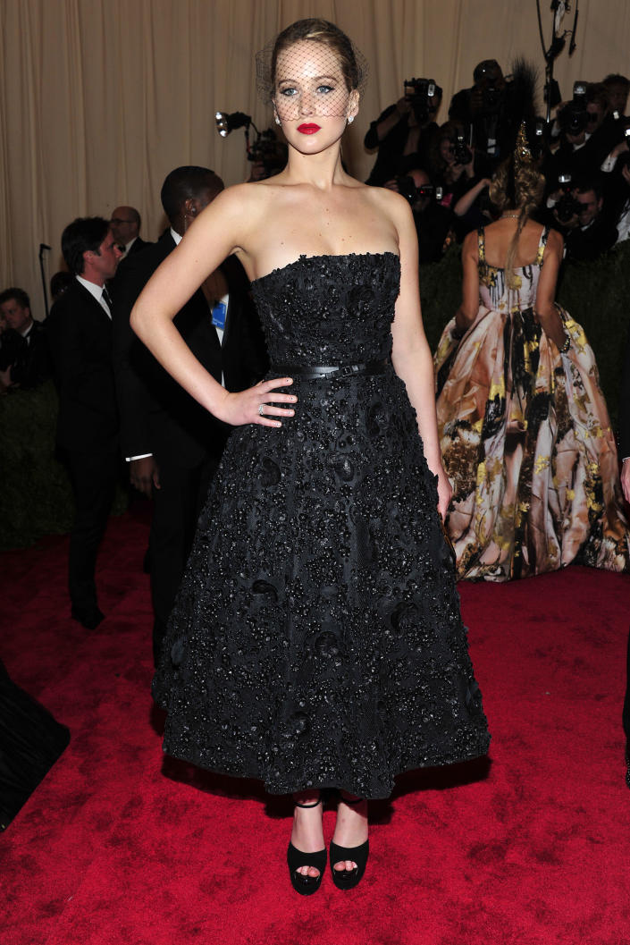 """Jennifer Lawrence attends The Metropolitan Museum of Art's Costume Institute benefit celebrating """"PUNK: Chaos to Couture"""" on Monday May 6, 2013 in New York. (Photo by Charles Sykes/Invision/AP)"""