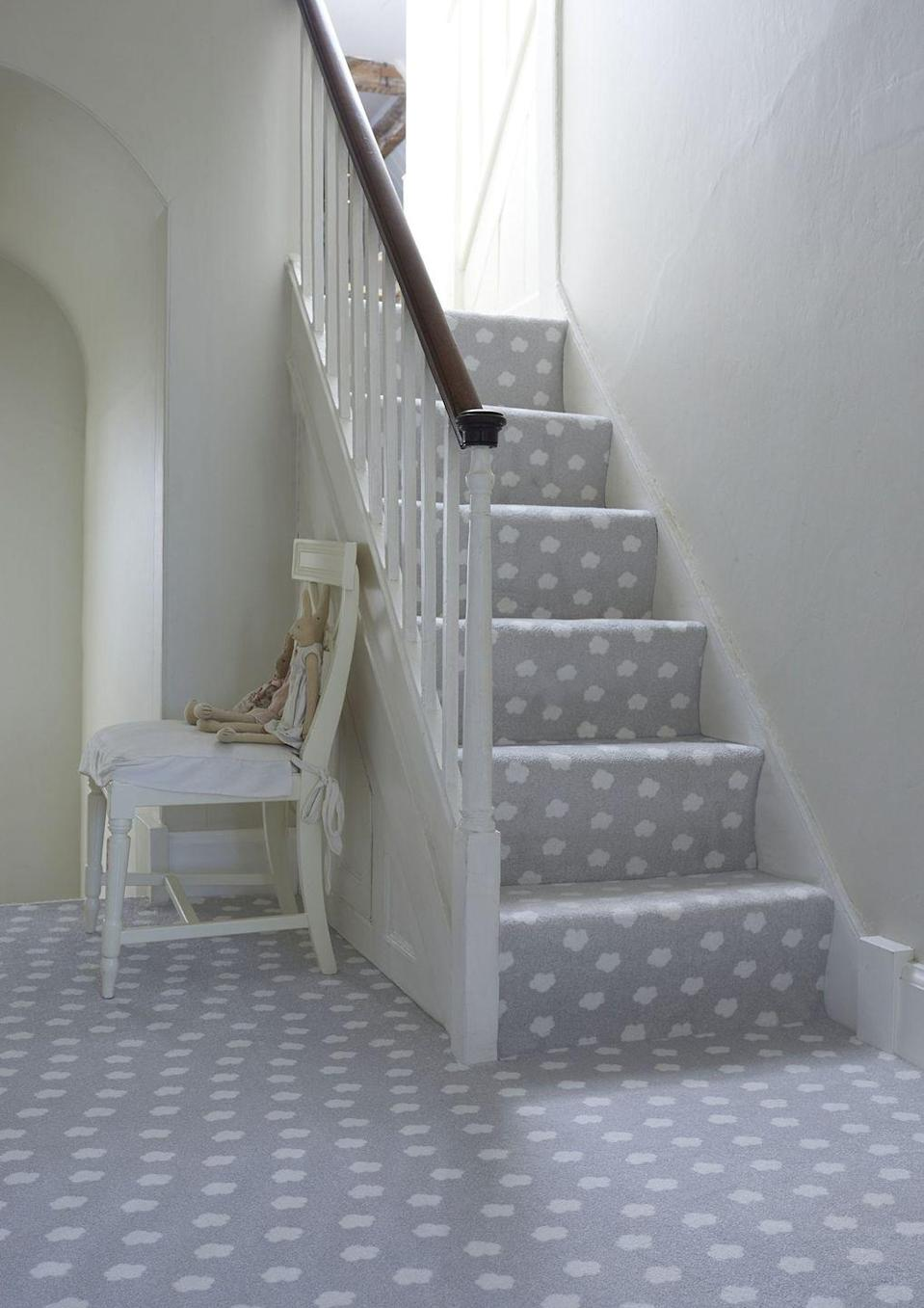 """<p>Shake up your interiors by turning your staircase into something fun for the kids — especially if it leads to one of their bedrooms. We love this classic grey stair carpet from Carpetright, which is adorned with white clouds. </p><p>Pictured: <a href=""""https://www.carpetright.co.uk/carpets/the-nursery-collection/"""" rel=""""nofollow noopener"""" target=""""_blank"""" data-ylk=""""slk:'The Nursery Collection Patterned Carpet in Daydream Silver' by Carpetright"""" class=""""link rapid-noclick-resp"""">'The Nursery Collection Patterned Carpet in Daydream Silver' by Carpetright</a>. </p>"""