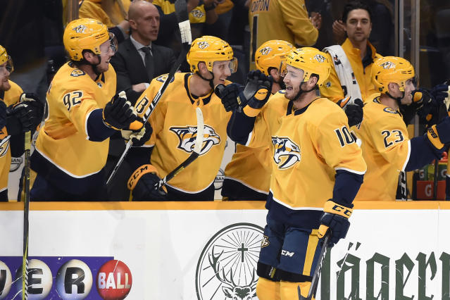 Nashville Predators center Colton Sissons (10) is congratulated after scoring a goal against the Anaheim Ducks during the first period of an NHL hockey game Tuesday, Oct. 22, 2019, in Nashville, Tenn. (AP Photo/Mark Zaleski)
