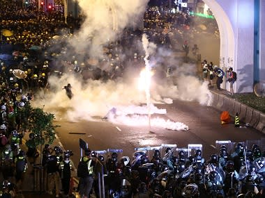 Hong Kong protests: Police fire tear gas, rubber bullets after protesters daub China's office with eggs, graffiti in rebuke to Beijing's rule