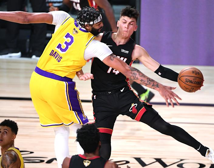 Lakers forward Anthony Davis forces Heat guard Tyler Herro into a turnover during Game 1.