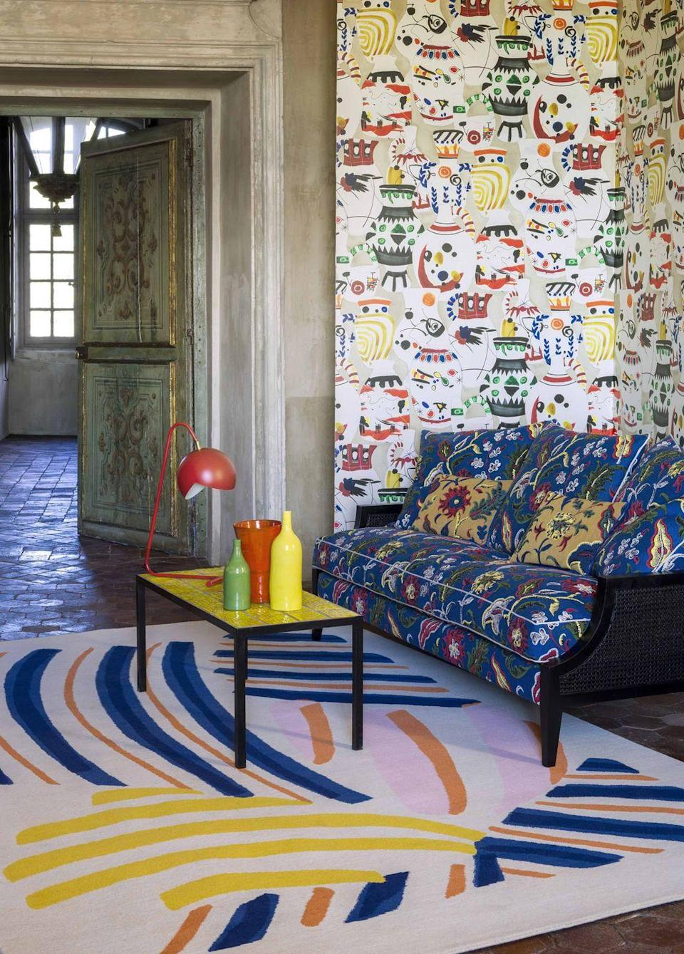 """<p>Transport yourself to warmer climes with the 'Eternel Été' wallpaper and the 'Joie De Vivre' fabric collections from Pierre Frey. Each design is inspired by the colours, artists and traditions of Provence. Pictured here is 'Vence' wallpaper, a sofa upholstered in 'Catherine' jacquard fabric and the 'Parasol' rug. From £75 per metre, <a href=""""https://www.pierrefrey.com/en/page/collection-eternel-ete"""" rel=""""nofollow noopener"""" target=""""_blank"""" data-ylk=""""slk:pierrefrey.com"""" class=""""link rapid-noclick-resp"""">pierrefrey.com</a></p>"""