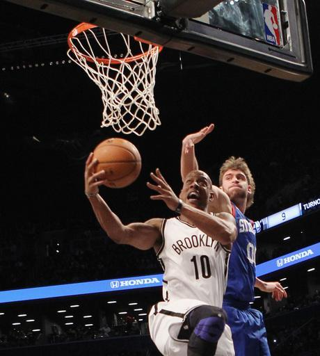 NEW YORK, NY - DECEMBER 23: Keith Bogans #10 of the Brooklyn Nets scores two in the fourth against the Philadelphia 76ers at Barclays Center on December 23, 2012 in the Brooklyn borough of New York City. (Photo by Bruce Bennett/Getty Images)