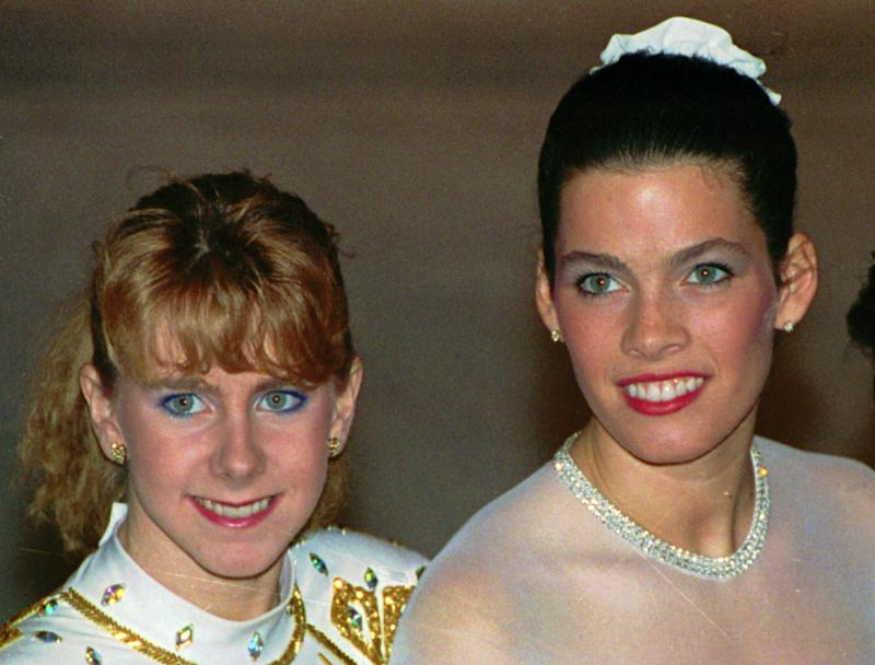 FILE - This Jan. 12, 1992 file photo shows Tonya Harding, left, and Nancy Kerrigan at the 1992 U.S. Figure Skating Championships in Orlando, Fla. On Saturday, July 27, 2013, NBC announced a documentary about the 1994 attack on Nancy Kerrigan to air during the upcoming Winter Olympics. (AP Photo/Phil Sandlin, File)