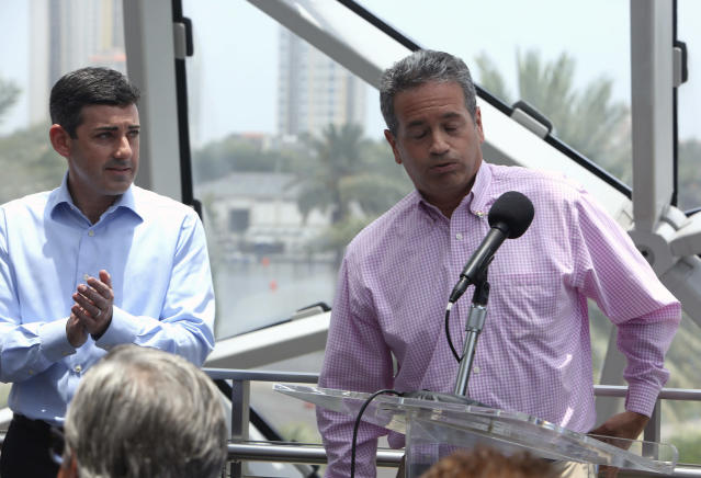 Tampa Bay Rays Principal Owner Stuart Sternberg reacts while answering questions at a press conference at the Dali Museum in St. Petersburg, Fla., Tuesday, June 25, 2019. Sternberg spoke about exploring the prospect of playing some future home games in Montreal. At left is Rays President of Baseball Operations Matthew Silverman. (Scott Keeler/Tampa Bay Times via AP)