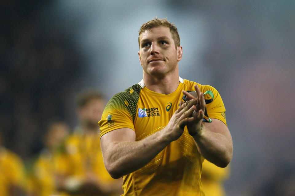 FILE - In this Oct. 31, 2015, file photo, Australia's David Pocock applauds the crowd after the Rugby World Cup final between New Zealand and Australia at Twickenham Stadium in London. Former Wallabies captain Pocock has quit professional rugby with a year to go on his contract in Japan so he can tackle his next challenge: improving the environment. He plans to devote his time to his conservation projects and the grassroots of the game in Australia and Zimbabwe. (AP Photo/Kirsty Wigglesworth, File)