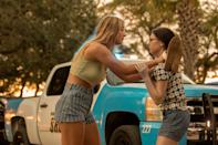 <p>Sarah pleads with her sister Wheezie while wearing a light green snap-button crop top from the Kendall and Kylie clothing collection and striped RVCA shorts, the latter of which are still available to shop online in select sizes.</p>