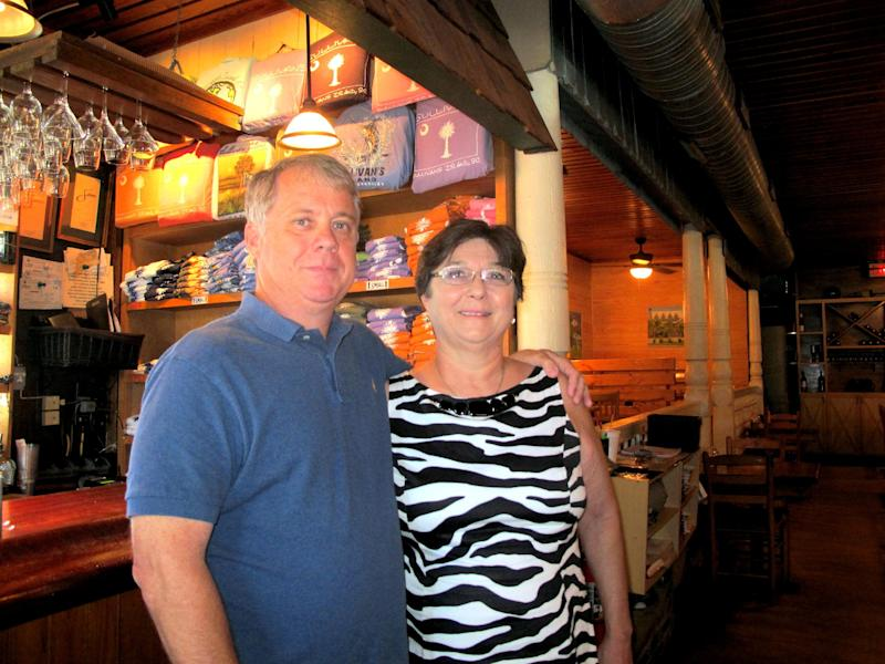 Sammy Rhodes and his sister, Donna Rhodes Hiott, pose inside Sullivan's, their family-owned seafood restaurant on Sullivans Island, S.C., on Sept. 12, 2013. The restaurant is one of about a dozen on Sullivans Island just outside Charleston, S.C. (AP Photo/Bruce Smith)