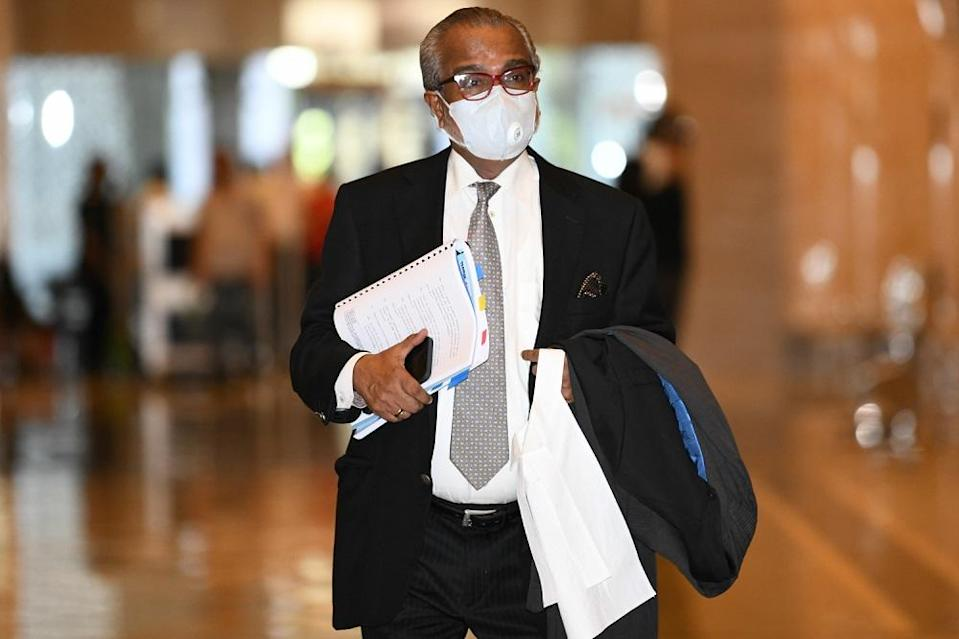 Lawyer Tan Sri Muhammad Shafee Abdullah arrives at the Court of Appeal in Putrajaya April 6, 2021. ― Picture by Shafwan Zaidon