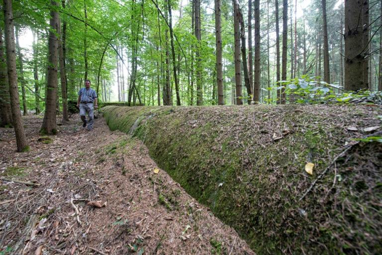 The giant drainage ducts that local historian Dieter Stockmann shows visits are now coated with moss and foilage (AFP Photo/THOMAS KIENZLE)