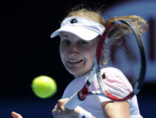 Ekaterina Makarova of Russia makes a forehand return during her first round match against Venus Williams of the U.S. at the Australian Open tennis championship in Melbourne, Australia, Monday, Jan. 13, 2014. (AP Photo/Andrew Brownbill)