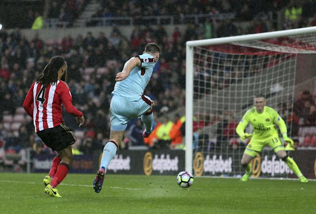 <p>Burnley's Sam Vokes has a shot on goal, during the English Premier League soccer match between Sunderland and Burnley </p>