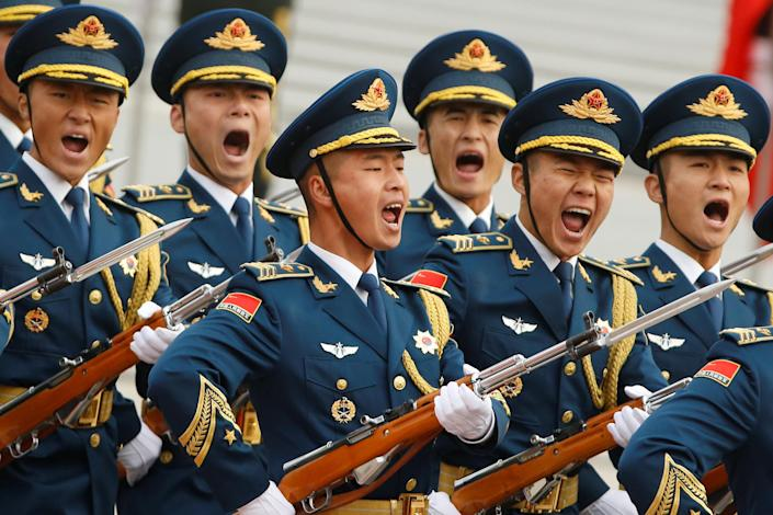 <p>Military troops march during a welcoming ceremony for U.S. President Donald Trump in Beijing, China, Nov. 9, 2017. (Photo: Thomas Pete/Reuters) </p>
