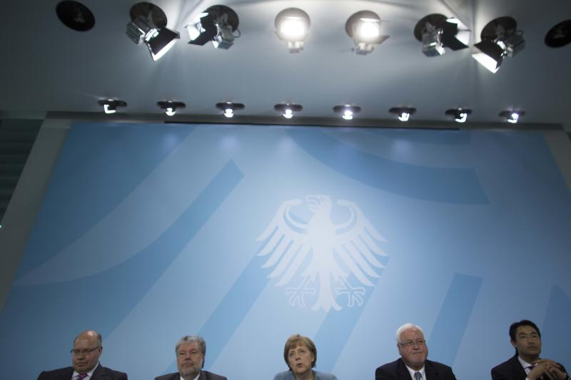 German Environment Minister Peter Altmaier, Rhineland-Palatinate state governor Kurt Beck, Chancellor Angela Merkel, Schleswig-Holstein state governor Peter Harry Carstensen and German Economic Minister Philipp Roesler attend a news conference after a meeting of the federal government and the German states about the countries' energy future at the chancellery in Berlin, Germany, on Wednesday, May 23, 2012. (AP Photo/Markus Schreiber)