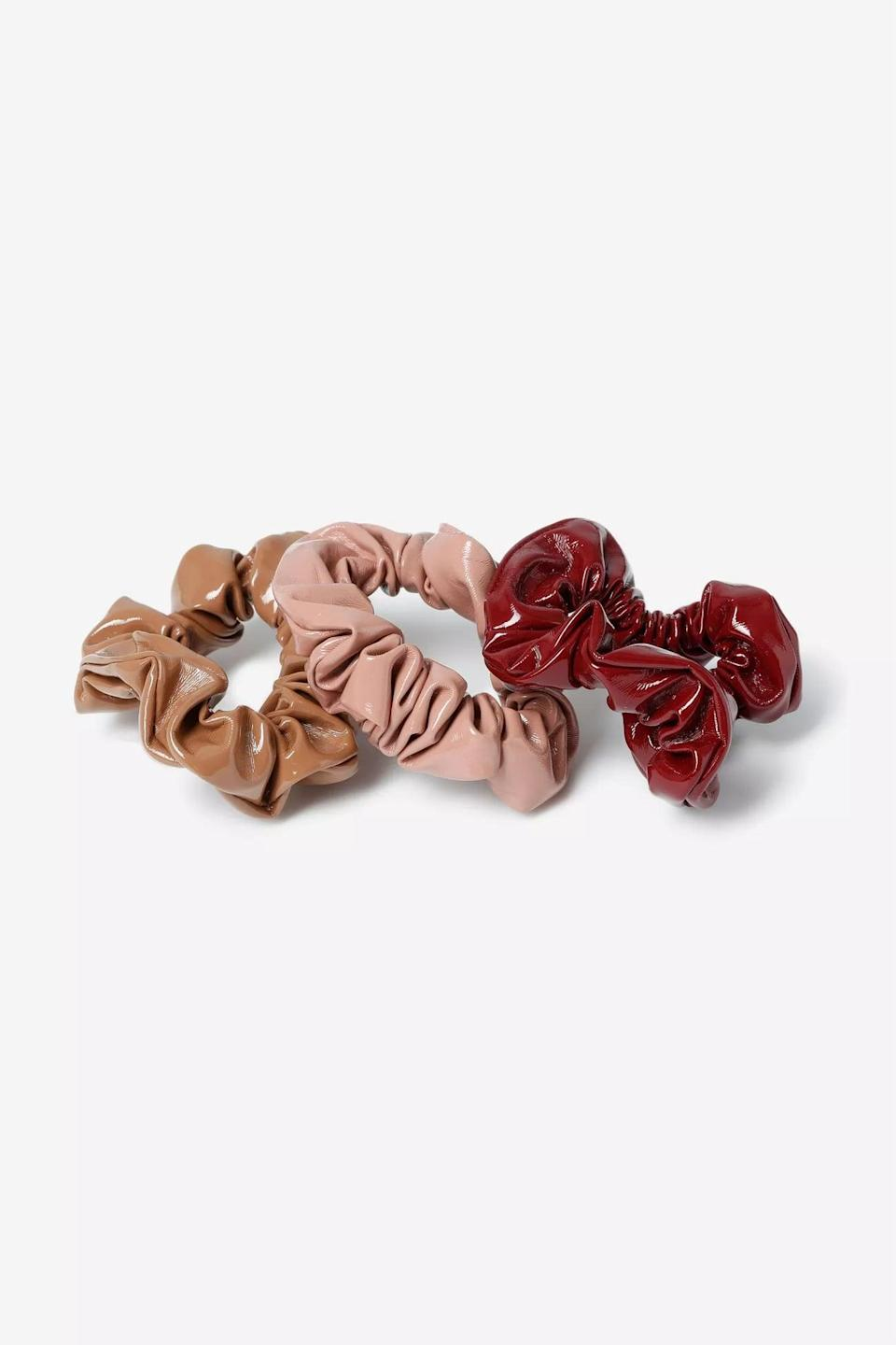 <p>Even your hair accessories can use a little edge. Try these <span>Vinyl Scrunchies</span> ($18 for three) for a change.</p>