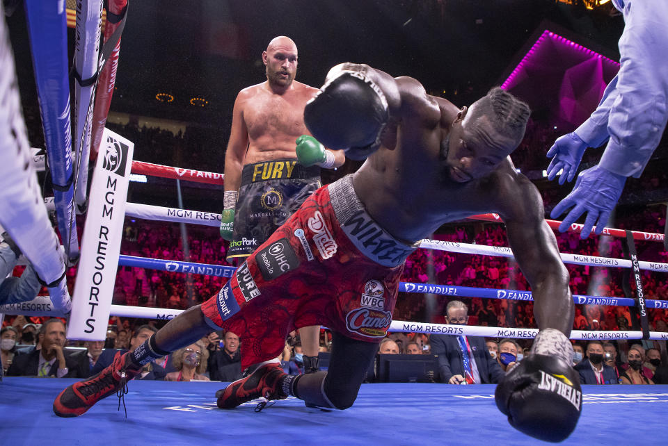 Pictured here, Deontay Wilder (R) crashes to the canvas during his trilogy fight defeat to Tyson Fury.