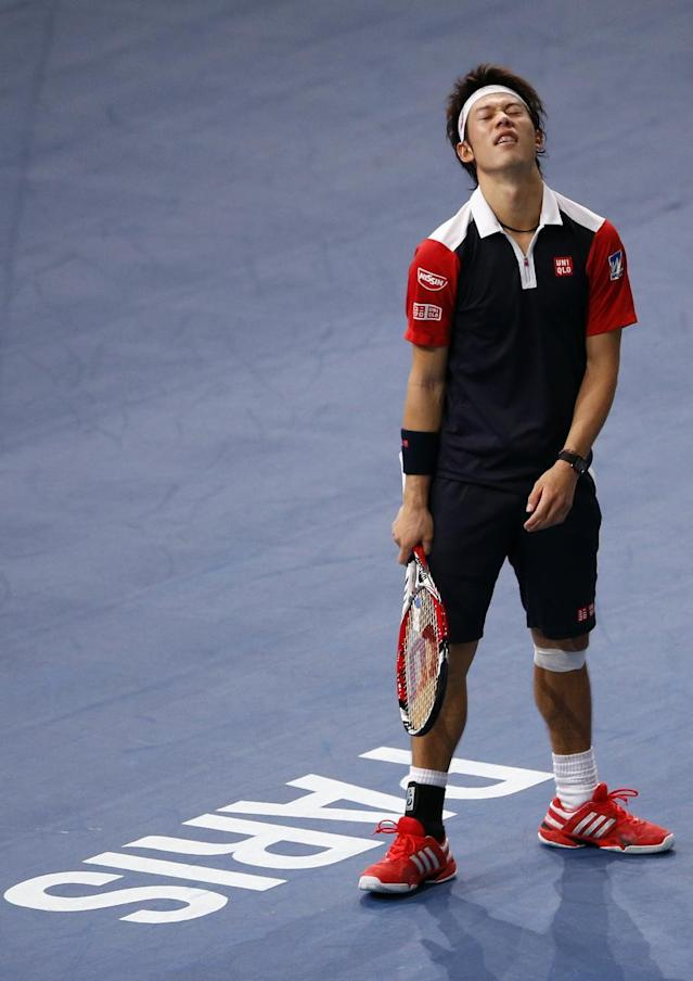 Japan's Kei Nishikori reacts after missing a ball to France's Jo-Wilfried Tsonga, during their second round match, at the Paris Masters tennis at Bercy Arena in Paris, France, Tuesday, Oct. 29, 2013. (AP Photo/Francois Mori)