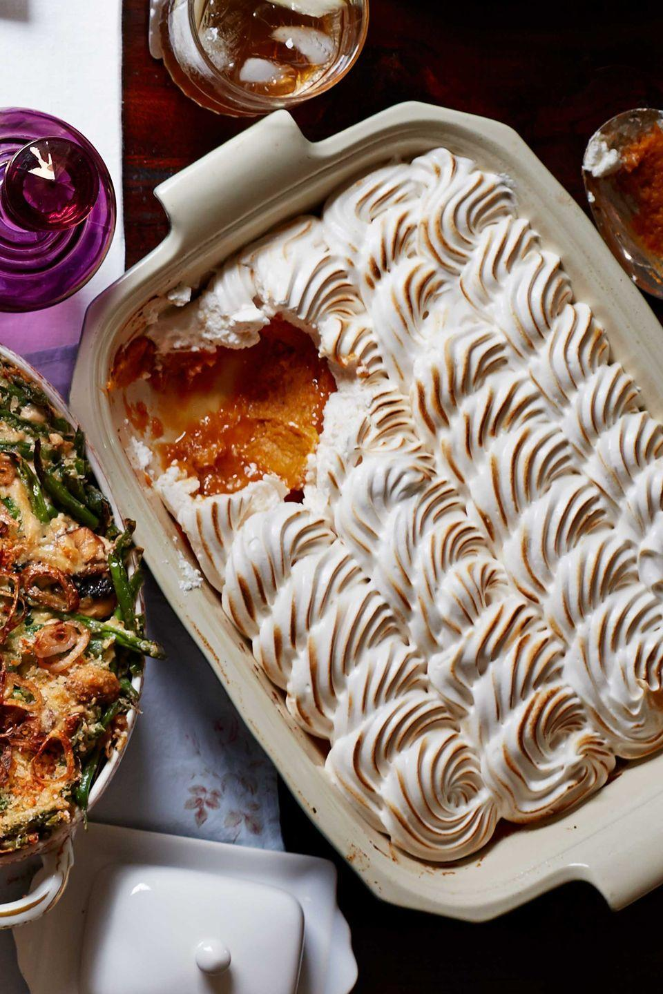 """<p>A sweet update to a holiday must-have. Roast and mash the sweet potatoes up to 2 days ahead and chill. Let stand at room temperature 30 minutes before proceeding with the recipe.</p><p><strong><a href=""""https://www.countryliving.com/food-drinks/recipes/a5865/maple-meringue-potato-casserole-recipe-clx1114/"""" rel=""""nofollow noopener"""" target=""""_blank"""" data-ylk=""""slk:Get the recipe"""" class=""""link rapid-noclick-resp"""">Get the recipe</a>.</strong></p>"""