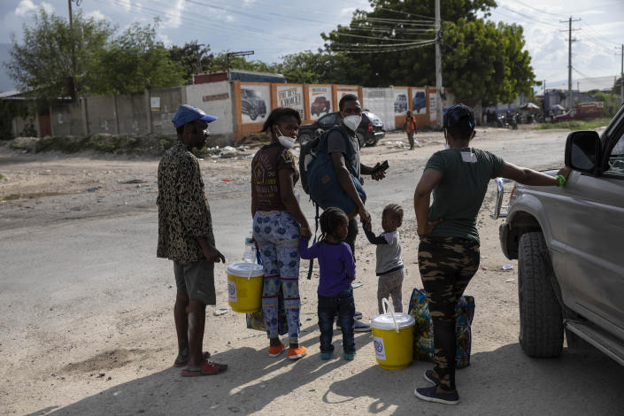 Haitian migrants deported from the US leave the Toussaint Louverture International Airport in Port-au-Prince, Haiti, Sunday, Sept. 19, 2021. Thousands of Haitian migrants have been arriving to Del Rio, Texas, to ask for asylum in the U.S., as authorities begin to deported them to back to Haiti. (AP Photo/Rodrigo Abd)