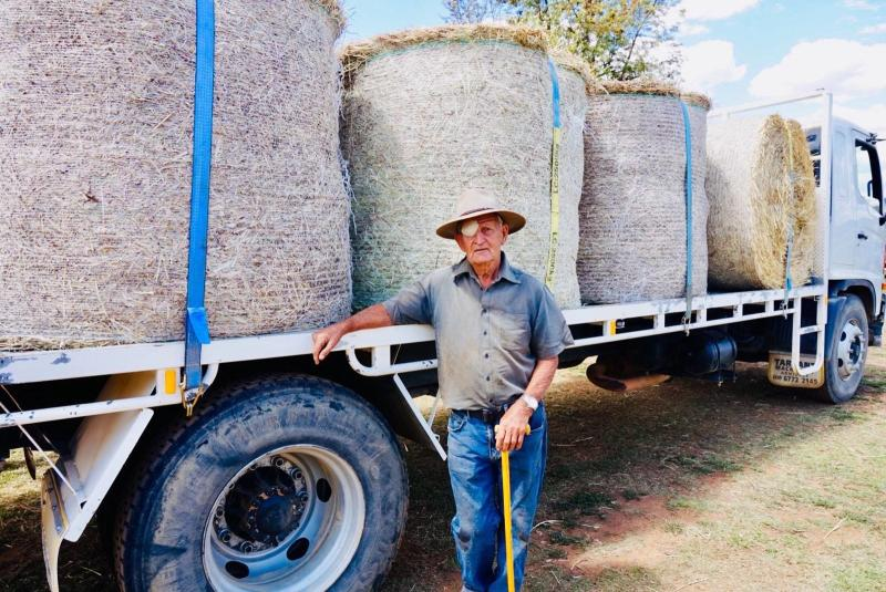 NSW cattle grazier Alf King stands beside a load of hay at his Bingara property.