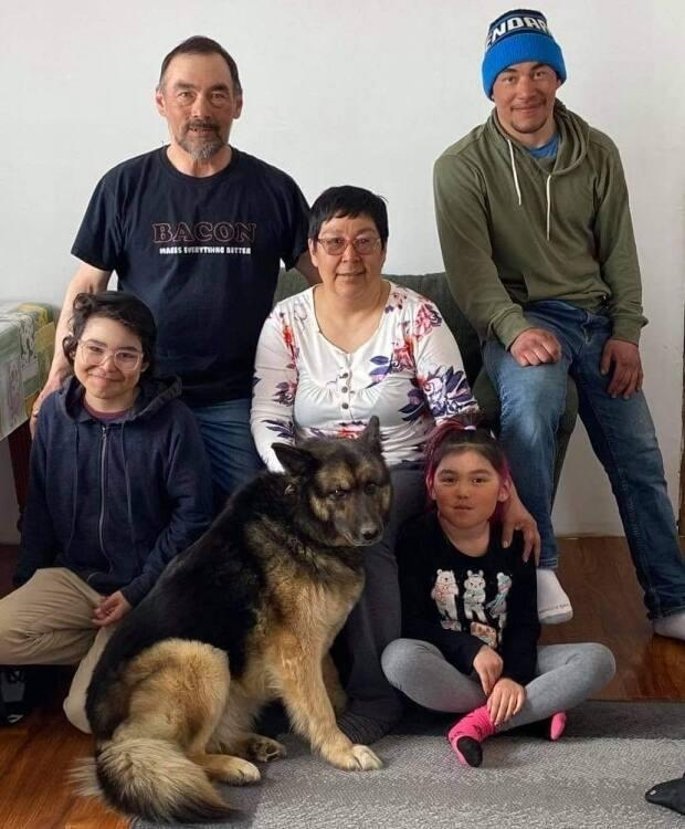 Adams and her family, with Pepper.