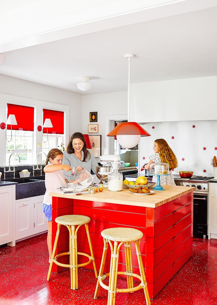 """<div class=""""caption""""> Brodsky in the kitchen with Frederica (left) and Beatriz. A pendant by <a href=""""https://richbrilliantwilling.com/"""" rel=""""nofollow noopener"""" target=""""_blank"""" data-ylk=""""slk:Rich Brilliant Willing"""" class=""""link rapid-noclick-resp"""">Rich Brilliant Willing</a> hangs over the island by <a href=""""https://www.boriesandshearron.com/"""" rel=""""nofollow noopener"""" target=""""_blank"""" data-ylk=""""slk:Bories & Shearron Architecture"""" class=""""link rapid-noclick-resp"""">Bories & Shearron Architecture</a>. Stools by <a href=""""https://www.serenaandlily.com/"""" rel=""""nofollow noopener"""" target=""""_blank"""" data-ylk=""""slk:Serena & Lily"""" class=""""link rapid-noclick-resp"""">Serena & Lily</a>. </div>"""