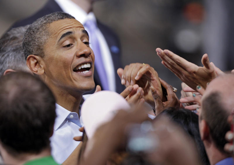 President Barack Obama greets supporters after a campaign rally at Ohio State University in Columbus, Ohio Saturday, May 5, 2012. (AP Photo/Mark Duncan)