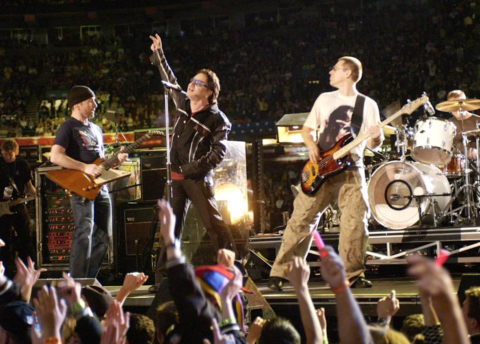 U2 performs during the halftime show at Super Bowl XXXVI in the Superdome, New Orleans, Louisiana, February 3, 2002. (Photo by KMazur/WireImage)