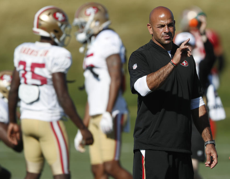 San Francisco 49ers defensive coordinator Robert Saleh directs players during a combined NFL training camp with the Denver Broncos Saturday, Aug. 17, 2019, at the Broncos' headquarters in Englewood, Colo. (AP Photo/David Zalubowski)