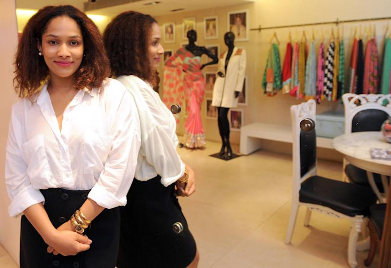 Indian fashion designer Masaba Gupta poses for a photo at her store in Mumbai, on July 28, 2014